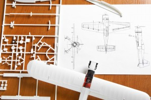 kit for assembling white plastic airplane model with scheme